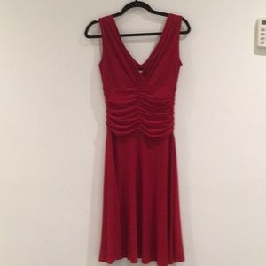 New without tags. Red dress by Tiana B.